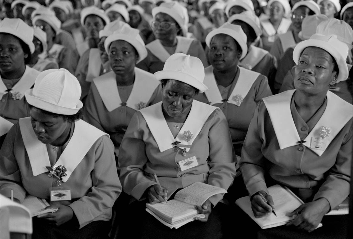 A ladies auxillary listen attentively and took notes as  Nelson Mandela gave a campaign speech at this church. Photo by Ozier Muhammad/The New York Times