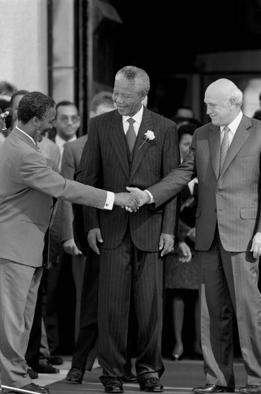The first non-racial inauguration in Siouth Africa's history. Left to right: Thabo Mbeki, Nelson Mandela, the new president, and former president F.W.deKlerk.