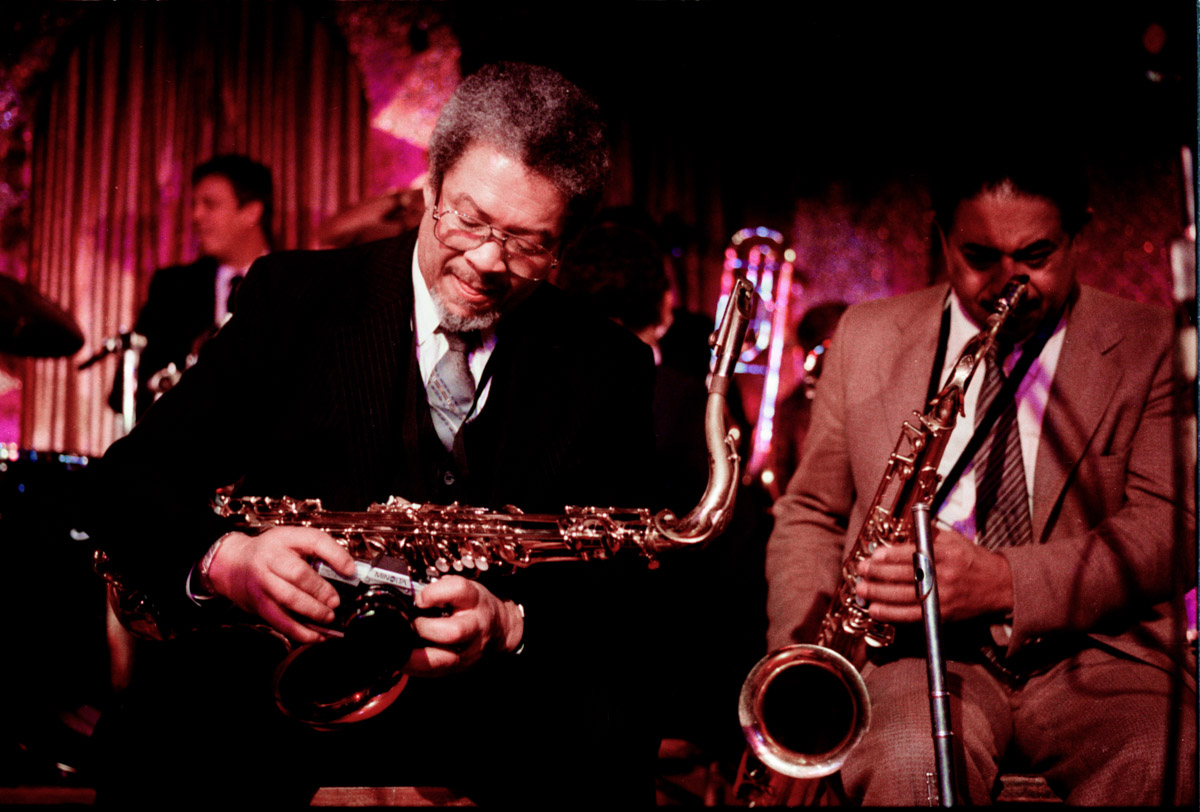 Left to right: Frank Foster and Frank Wess, jazz legends, who played tenor saxophones, flute and other reed instruments throughout their illustrious carreers, are seen here at a book party for author Albert Murray. Mr. Foster was an amateur photographer. This was an aggregate of musicians who were playing in the current Count Basie Orchestra, and some had played from the very beginning of the orchestra back in the early 1930's.