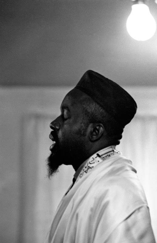 A black rabbi, of an orthodox jewish community, sang during a sabbath service.