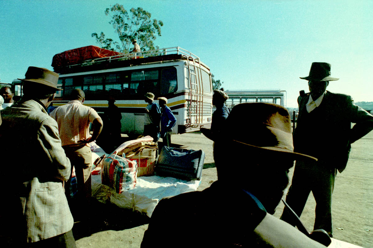 December 1989 - Mostly men waiting to board a bus in this town, where Nelson Mandela was born. This is the Transkei region.