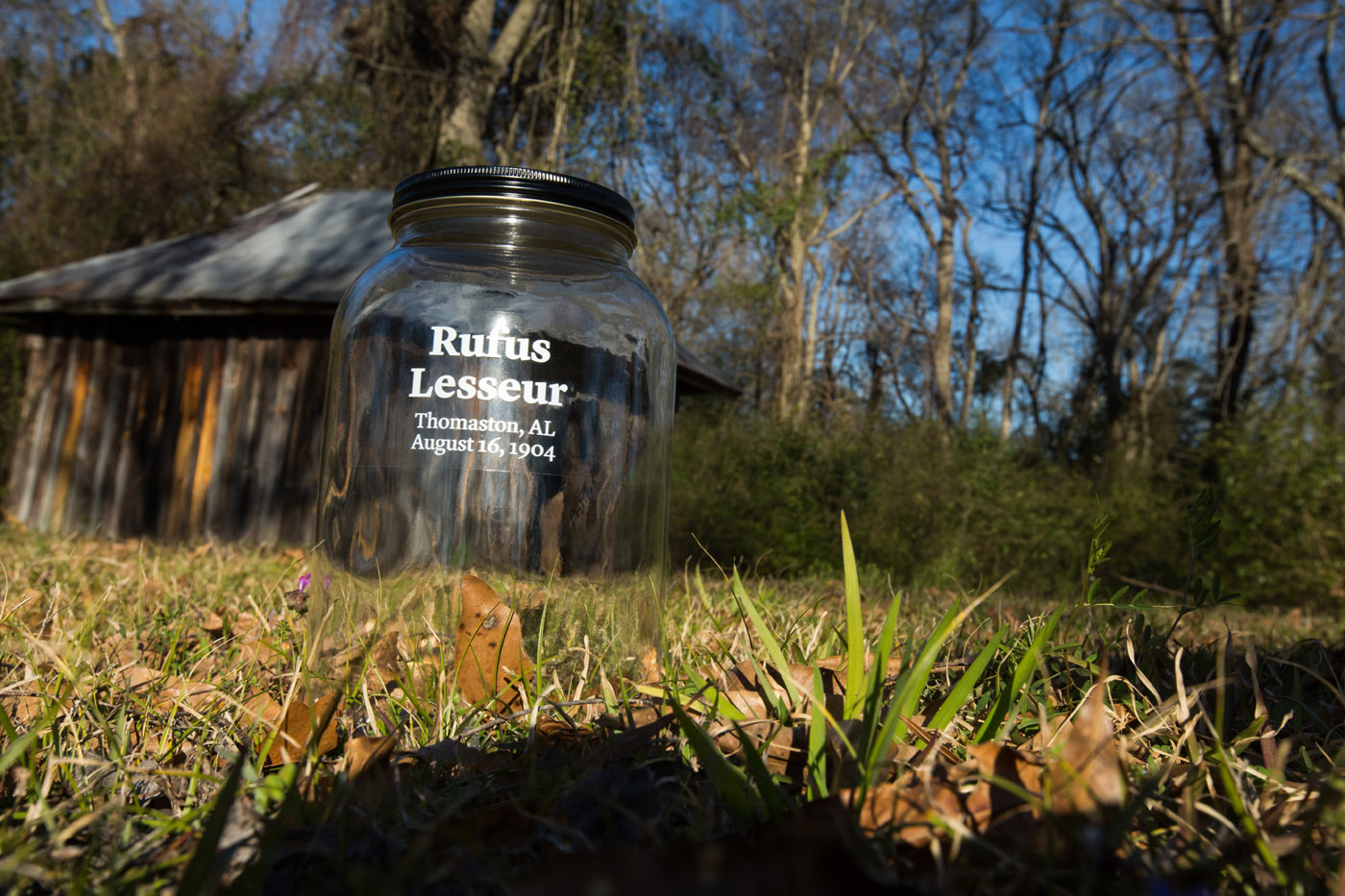 Thomaston, Ala - 02-12-16 - This capped jar is the type which used and inscribed the names of lynch victims. This capped jar  was later filled with soil from this site where Mr.Lesseur, was first detained and later lynched on August 16, 1904. He was accused of raping a white woman on Aug. 14 of that year. This is a soil collecting for the lynch site project, for The Equal Justice Initiative. - Credit Photo by Ozier Muhammad