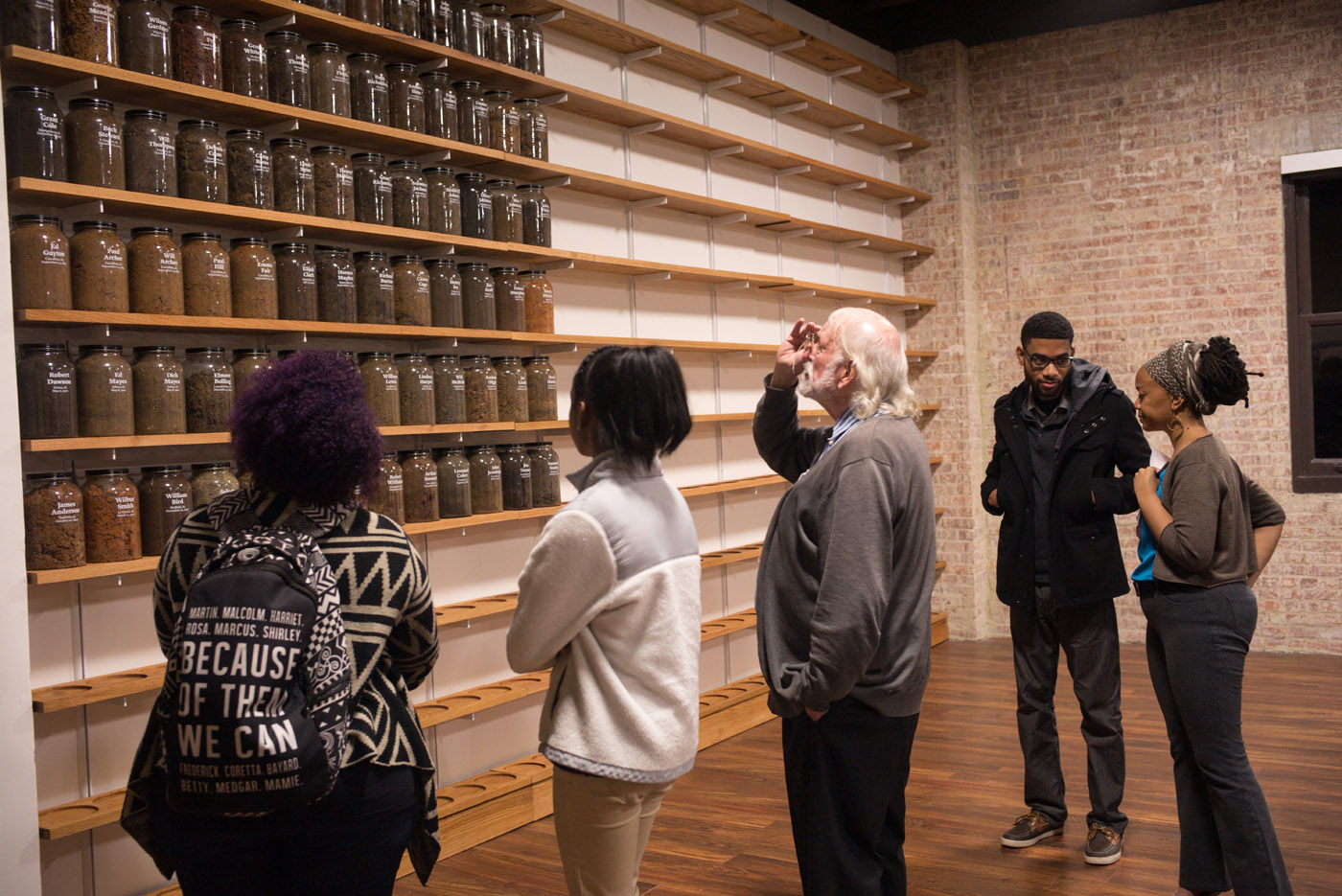 Montgomery, Ala - 02-11-16 - Visitors to EJI, take a look at capped jars with the names of victims of lynching inscribed. This was a temporary display of what eventually will be displayed in  The National Memorial For Peace and Justice, that will be located yards from the headquarters of the Equal Justice Initiative. - Credit Photo by Ozier Muhammad