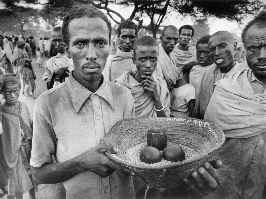 A man holds a week of provisions provided by one of the non govvernmental organizations that responded to the famine crisis.