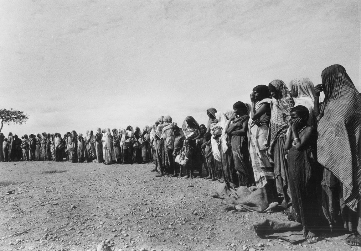 A queue of mostly women with their children wait for food at a dislocation camp in the Ogaden region.