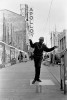 "May, 1993 - This fellow calls himself ""Dancing Harry."" He can usually be found near the world famous Apollo Theater making his moves on a slick board to the sounds of Soul Brother #1 James Brown."