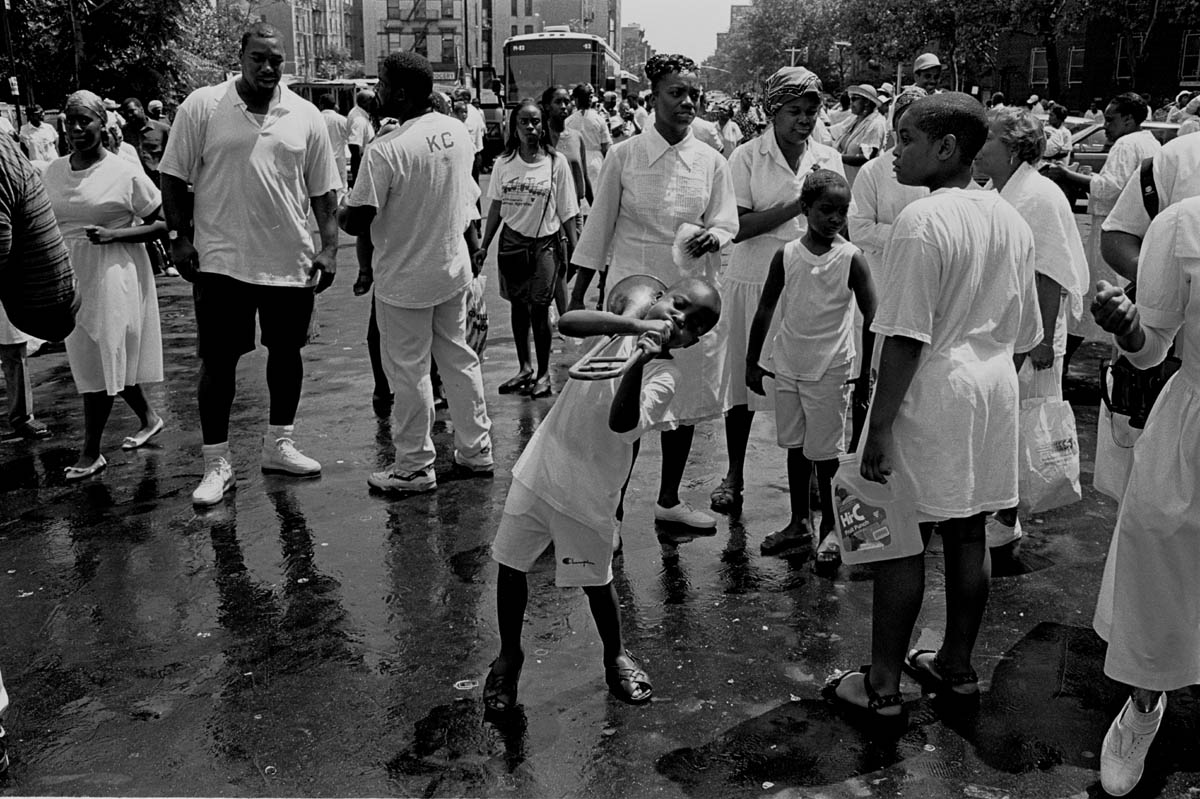 More than a hundred followers of Daddy Grace gather in Central Harlem, for an annual August street baptism, organized by the United House of Prayer in Harlem.