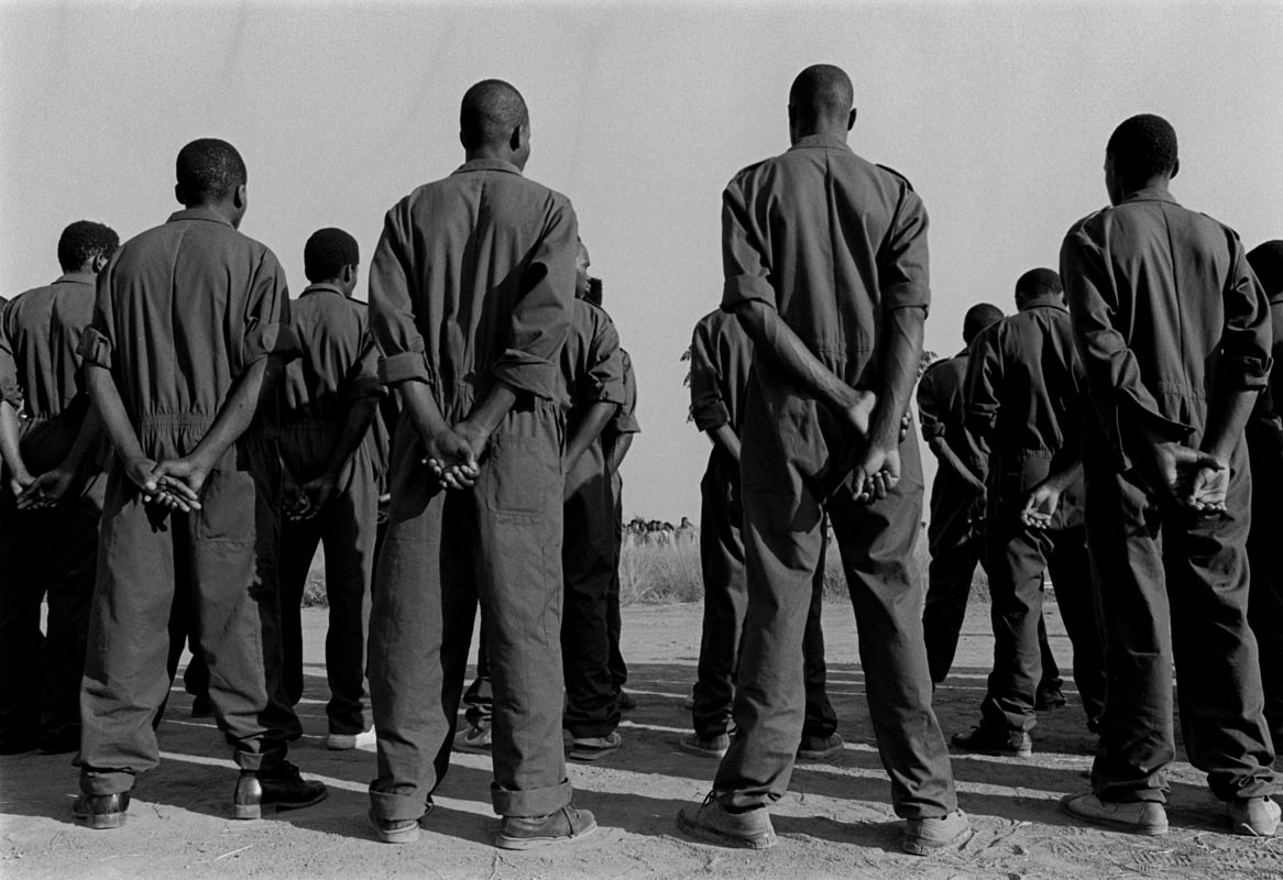 These black soliders line up at a training facility for the SADF. Photo by Ozier Muhammad/The New York Times
