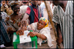 An elderly votes casts her ballot in the first open presidential election in Nigeria's history.