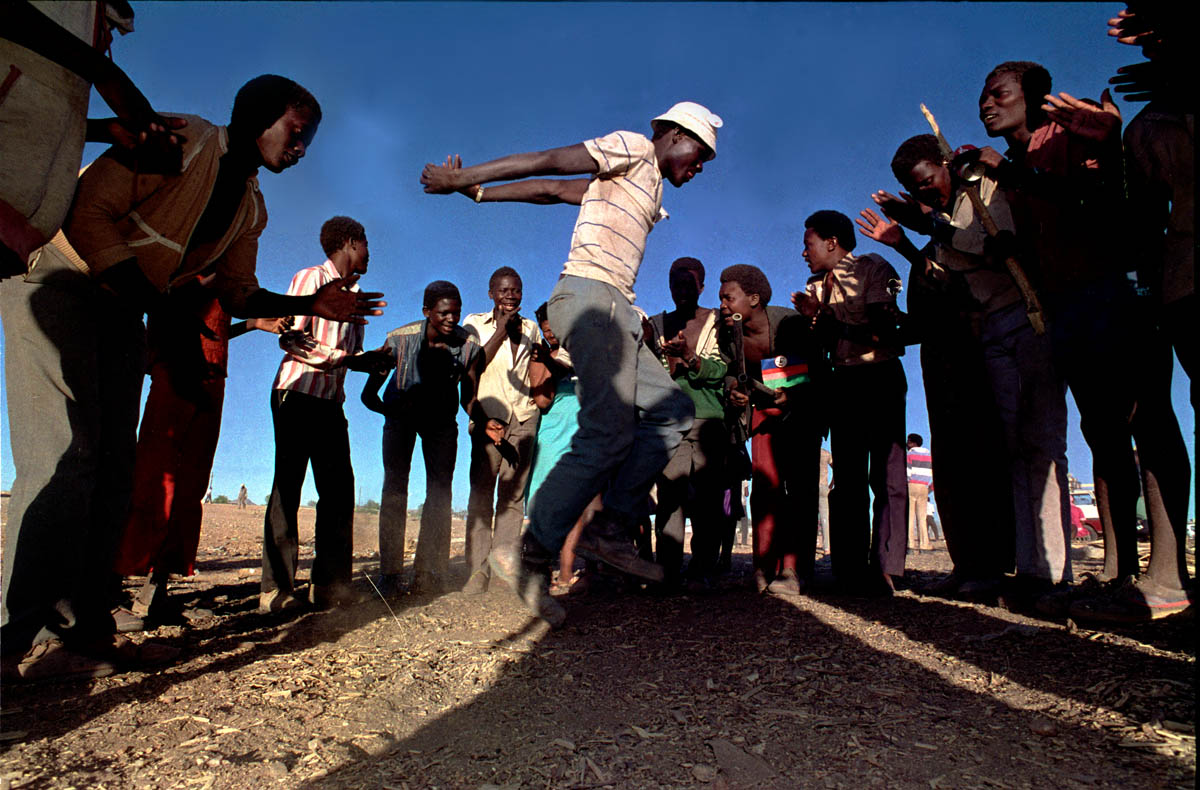 1989 - These men  provided syncopated clapping as a man danced and jumped after the United Naiton declared that SWAPO, the Southwest African Peoples Party had defeated the Democratic Turnhall Coalition, a satelite political organization which was endorsed by the Nartional Party of South Africa.