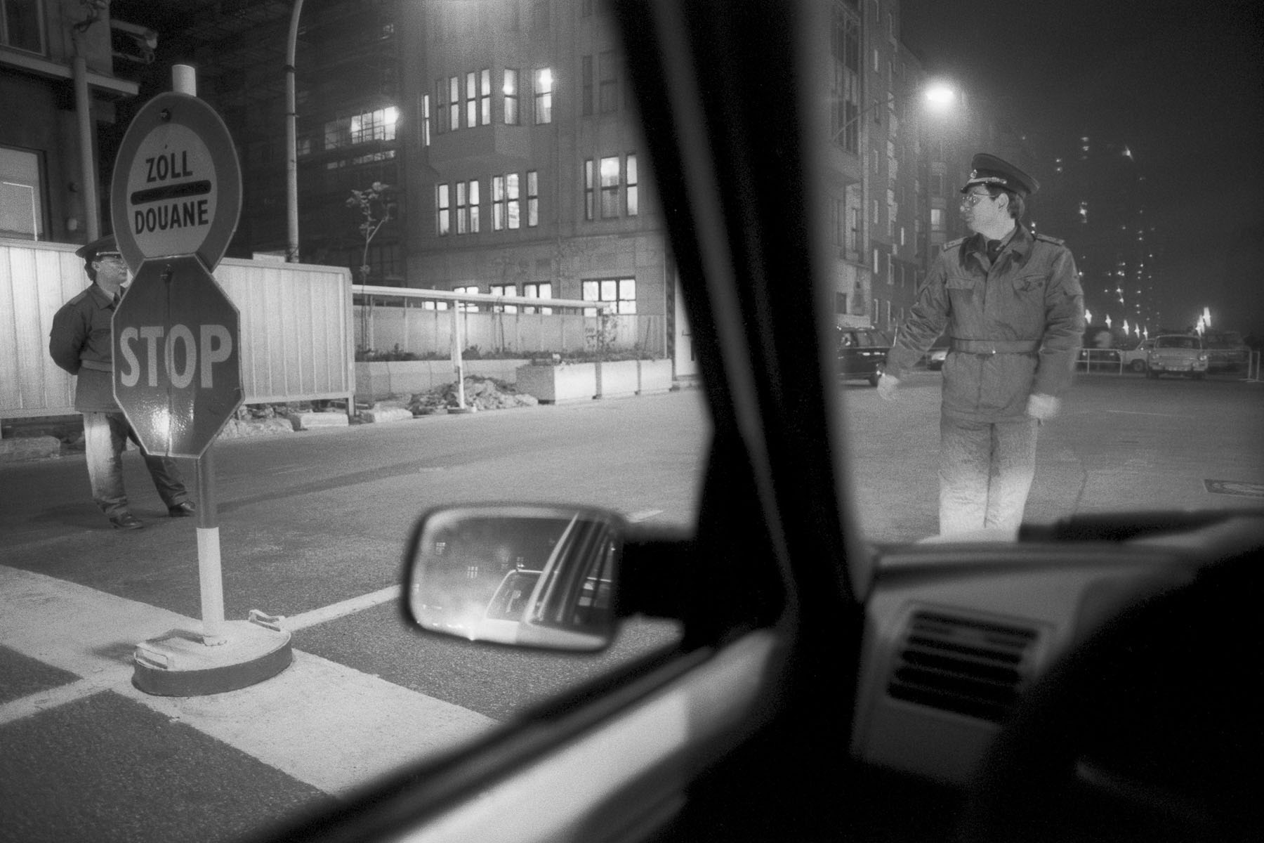 East-German soldier at Checkpoint Charlie, crossing point between East and West Berlin on November 10, 1989