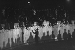 When the opening of the border is announced West-Berliners gather and climb on the wall next to the Brandenburg Gate on November 10, 1989