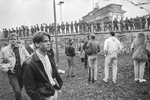 West Berliners walk by the Brandenburg Gate on november 10, 1989