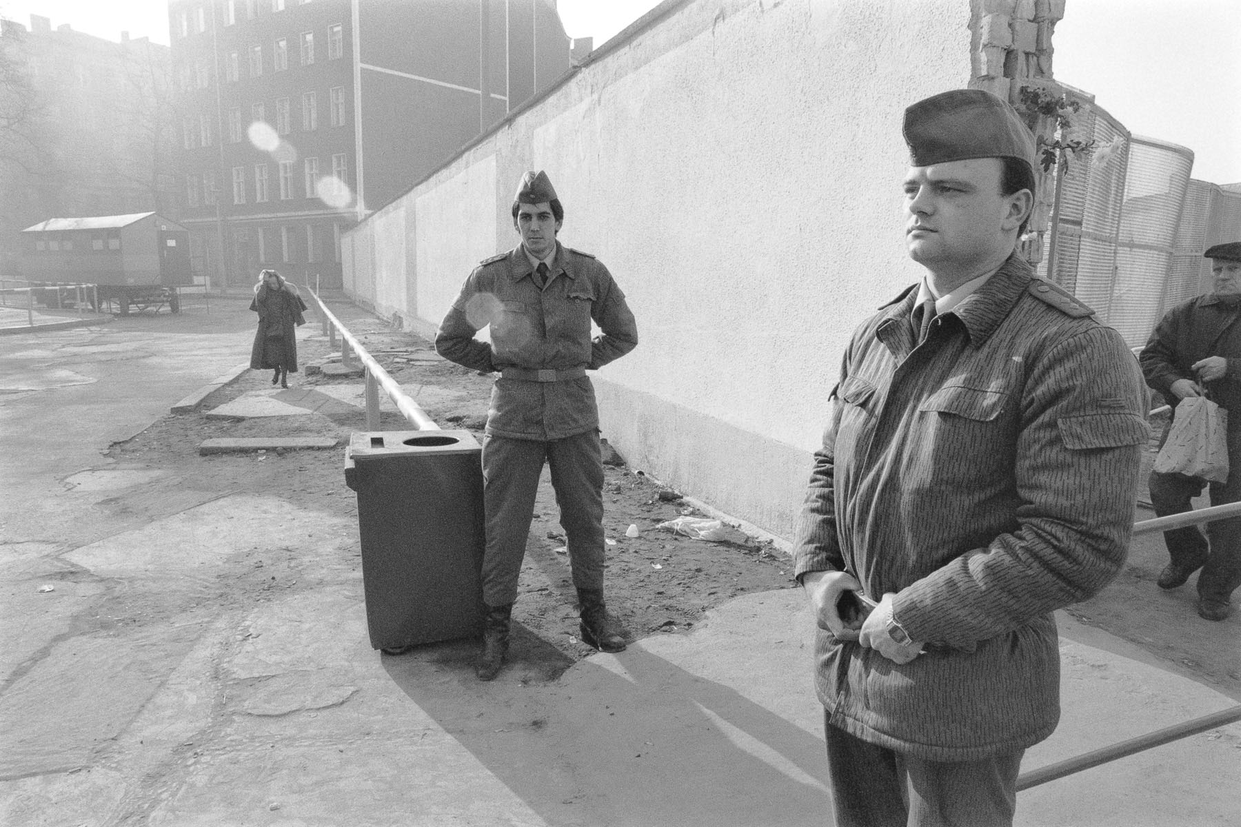 East German soldiers control East Berliners at a checkpoint . November 11, 1989