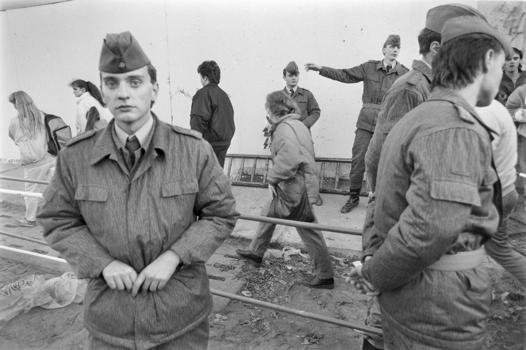 East Berliners cross a check-point in front of East German soldiers on November 11, 1989