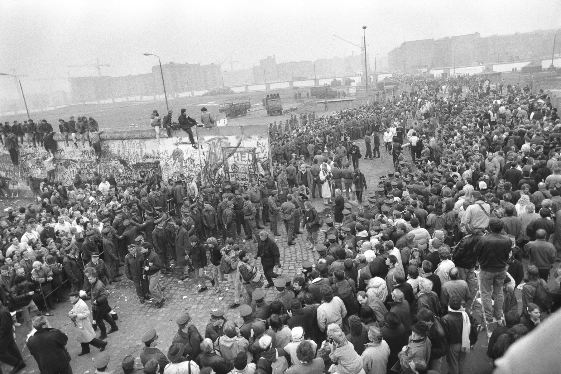 East Berliners cross an opening section of the Berlin Wall by Potzdamer Platz on November 11, 1989