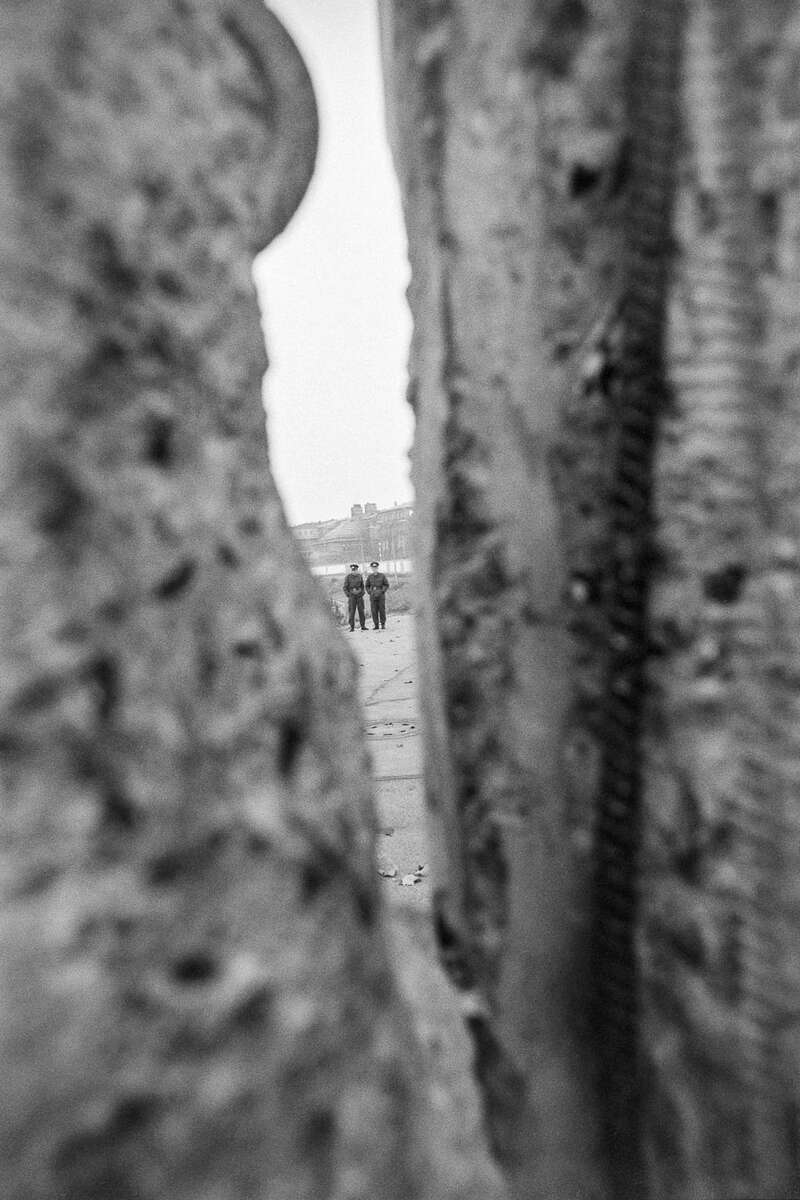 East German soldiers by the Berlin Wall by Potzdamer Platz on November 11, 1989