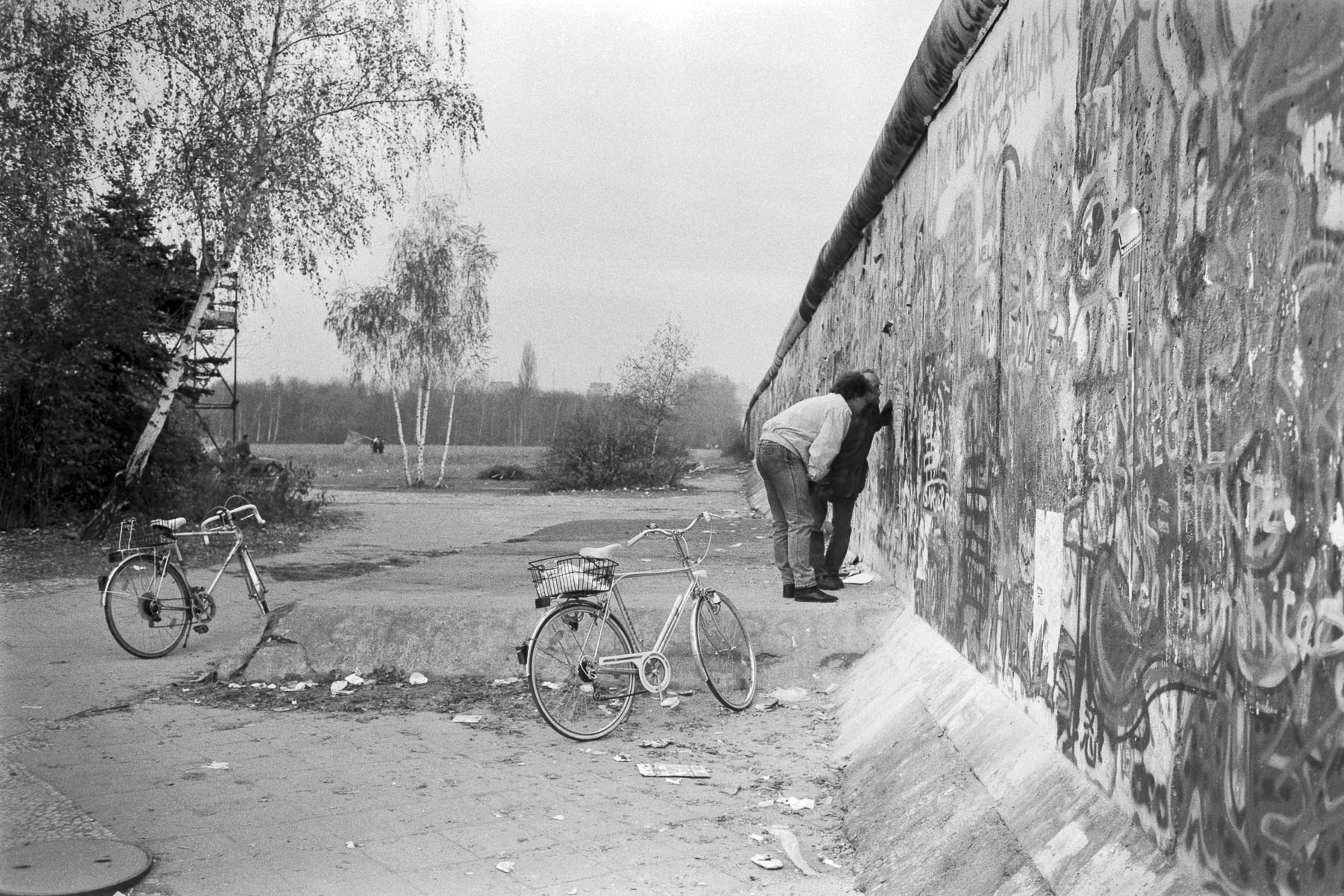 West Germans look through a hole in the Berlin Wall on November 11, 1989