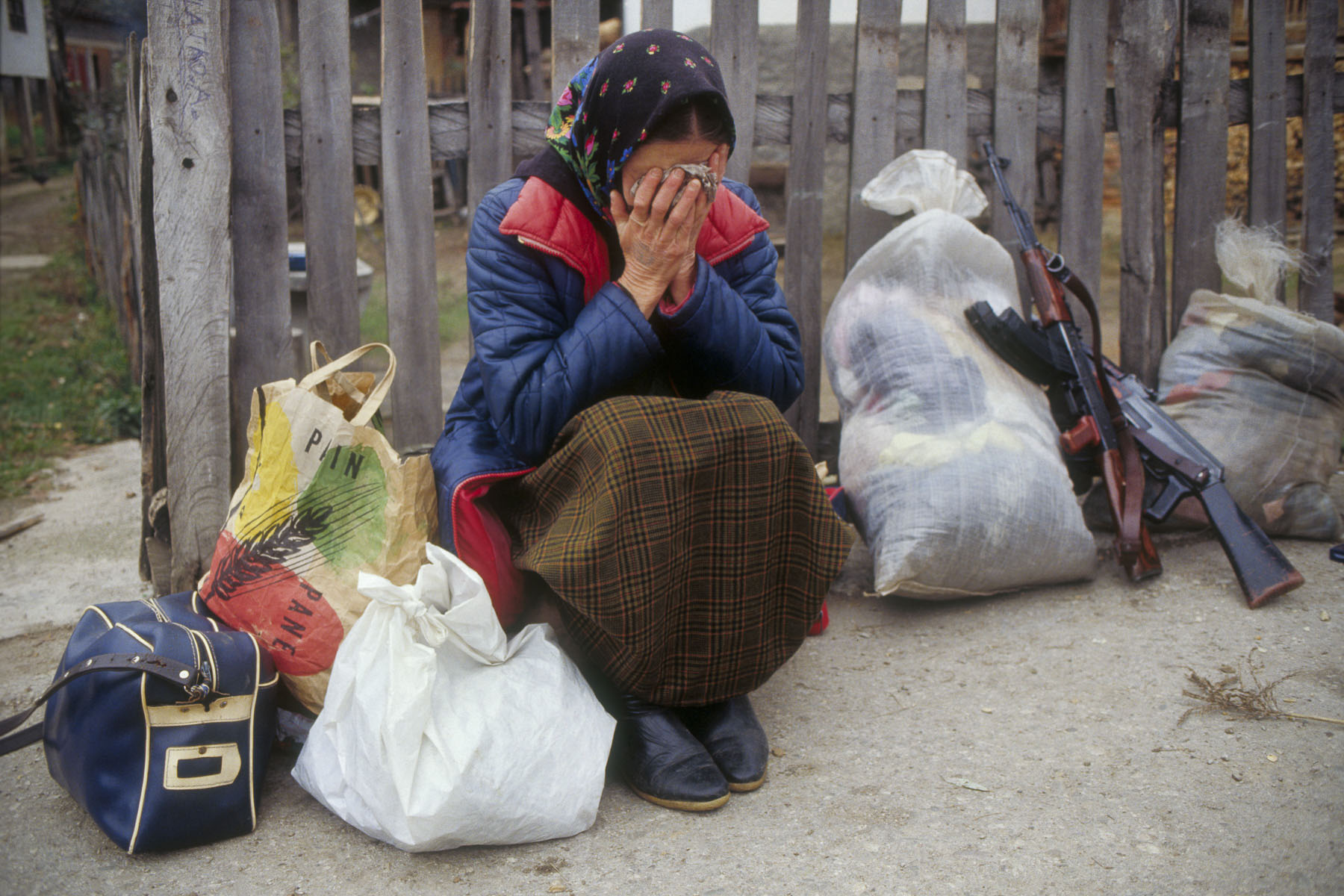 Bosnian refugee after the capture of her village by the Serb militiamen in November 1992