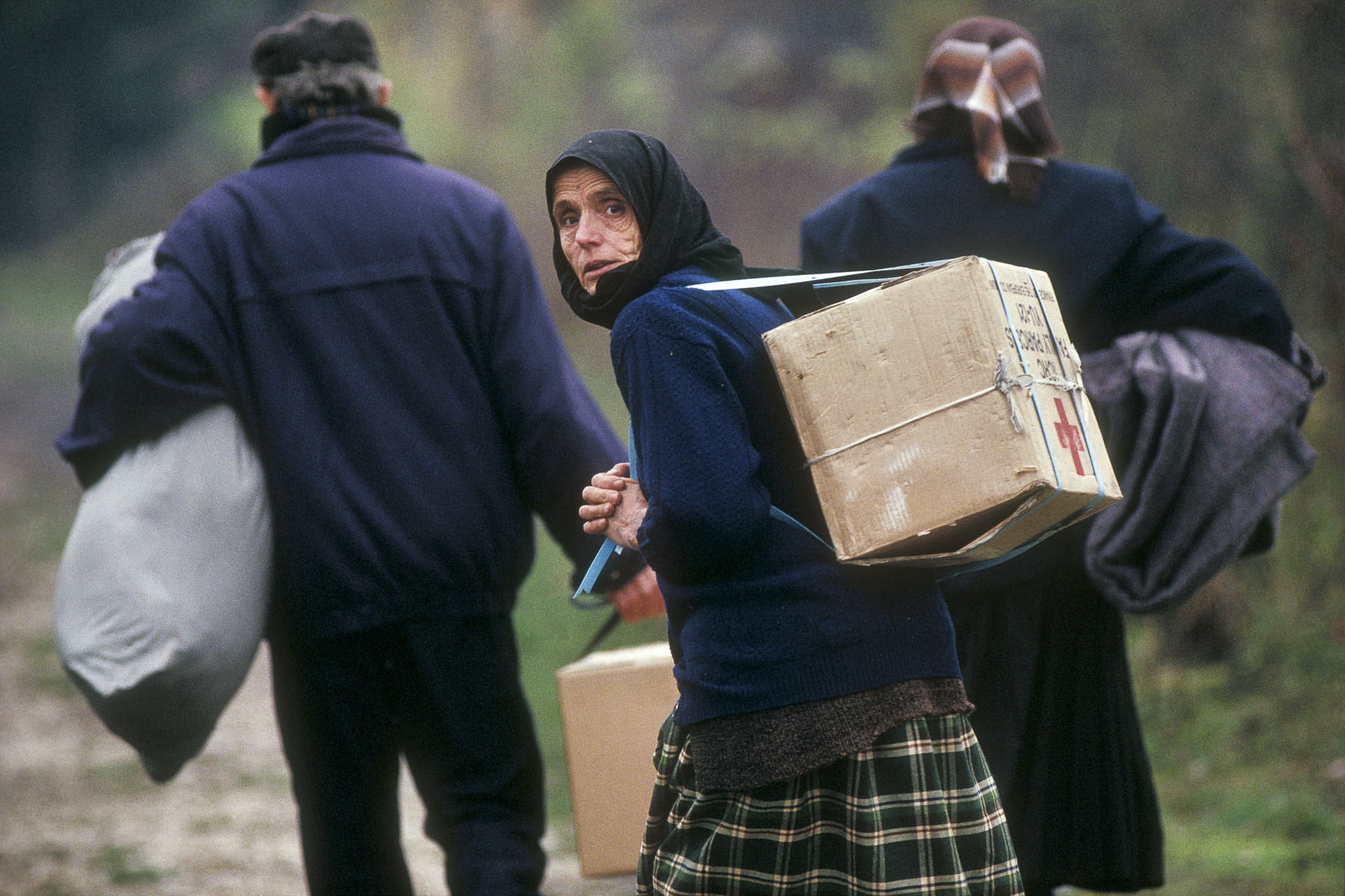 Bosnian refugees after the capture of their village by the Serb militiamen in November 1992