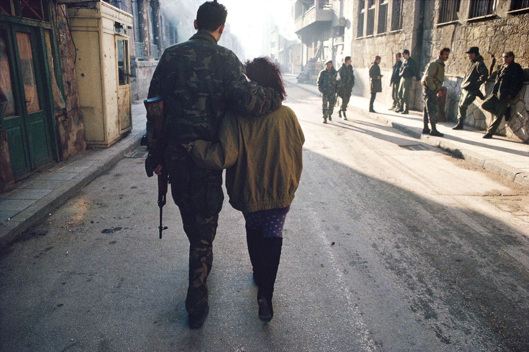 Couple in a street of the Muslim area of Mostar besieged by the Croatian militias in January 1994
