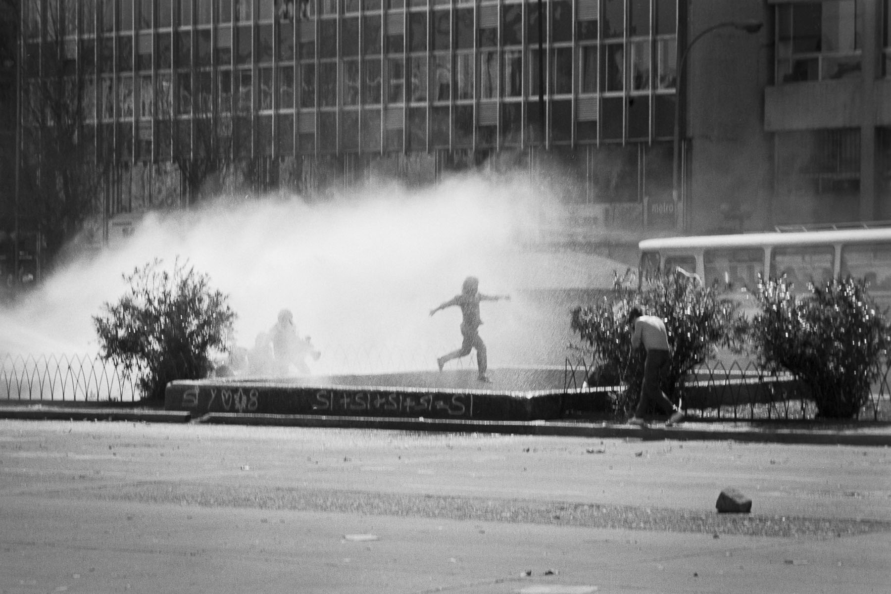 Anti-government demonstrators clash with police during plebiscite campaign vote in September 1988