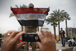 Demonstrators protest against President Mubarak's regime on Al-Tahrir Square on Sunday February 6 2011
