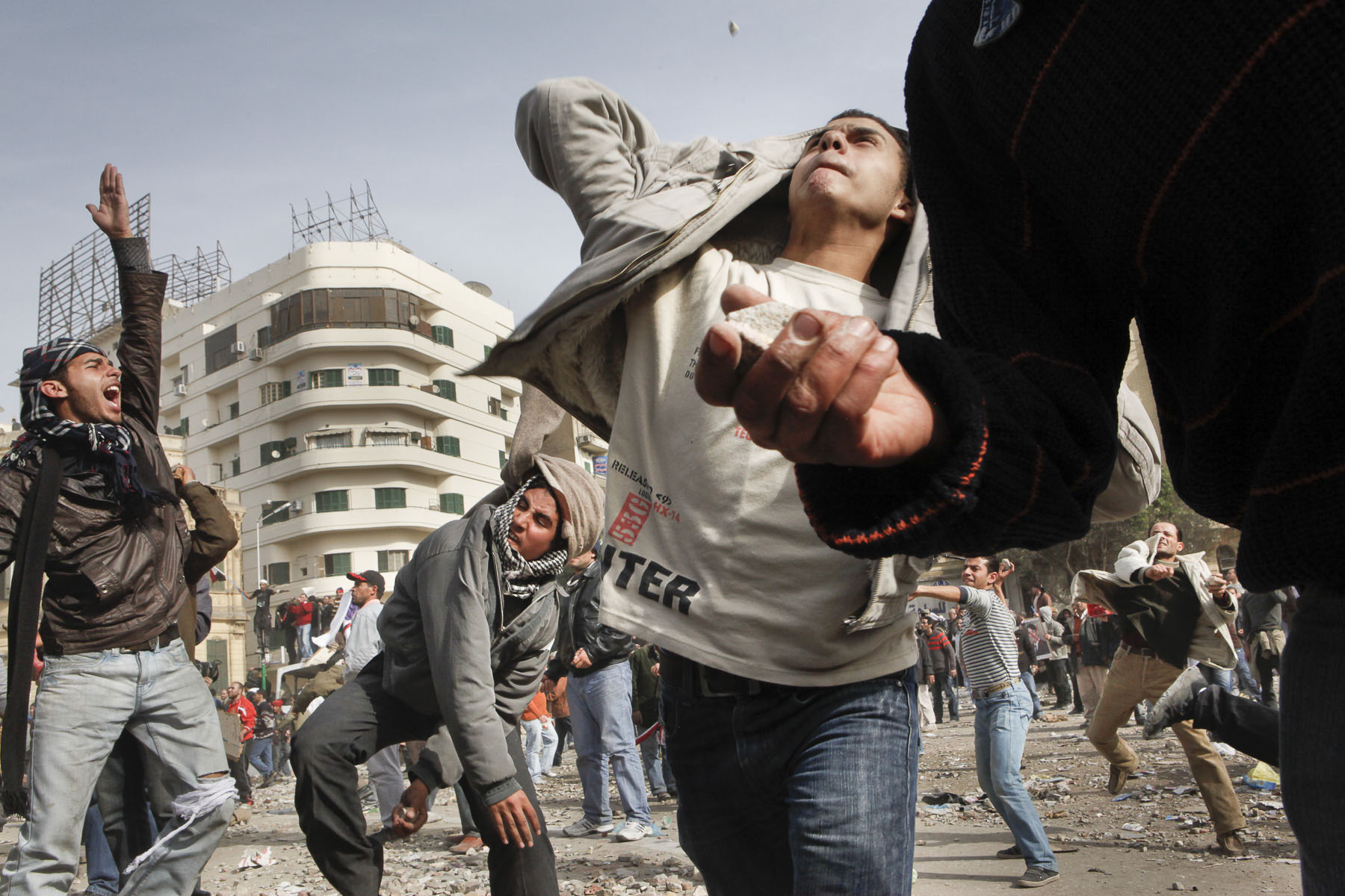 Anti-government demonstrators throw stones during a clash with President Mubarak's supporters on Tahrir Square on Thursday February 3 2011