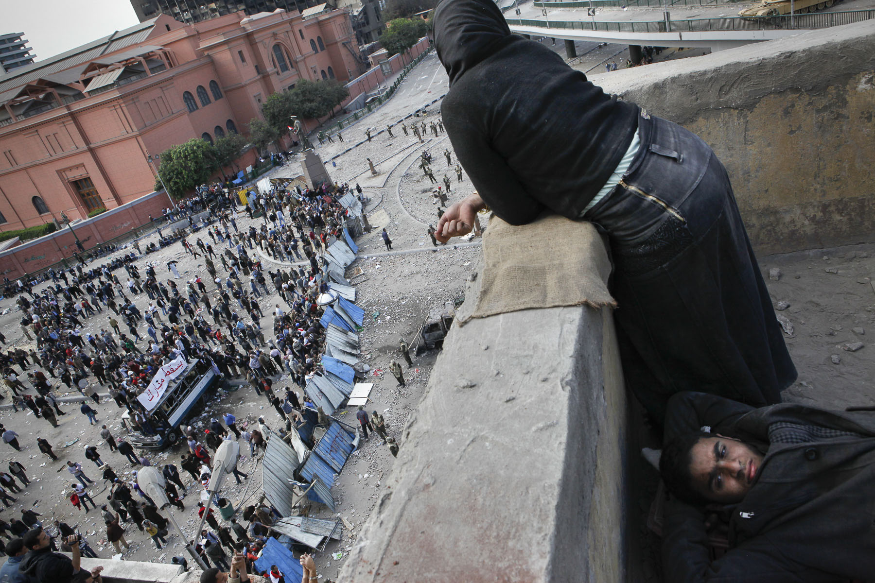 Anti-President Mubarak's demonstrators rest after a night of fights on Tahrir Square on Thursday February 3 2011