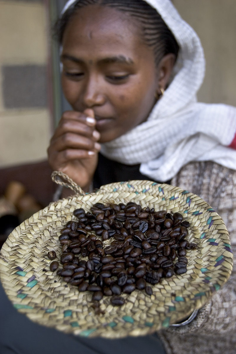 Coffee ceremony at the Museum of Addis Adeba Cafeteria. Young woman presenting roasted coffee in November 2004