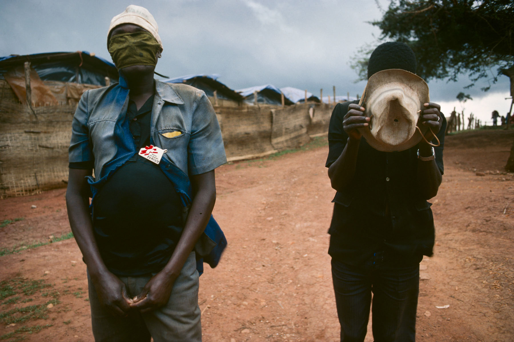 «Doctors Without Borders» employees during a storm in the Burundese Hutu refugee camp of Kanage in February 1994