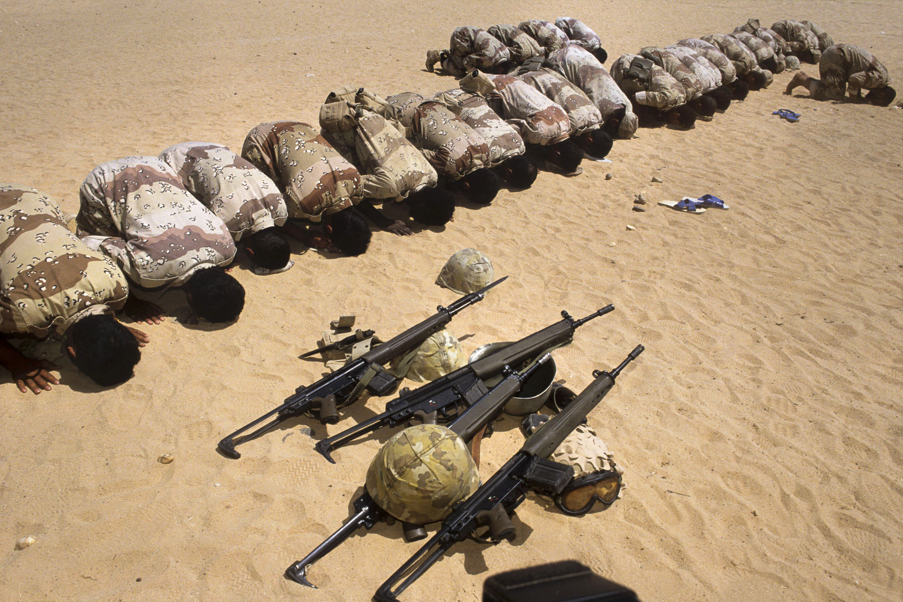 Egyptian soldiers praying somewhere in the desert in January 1991