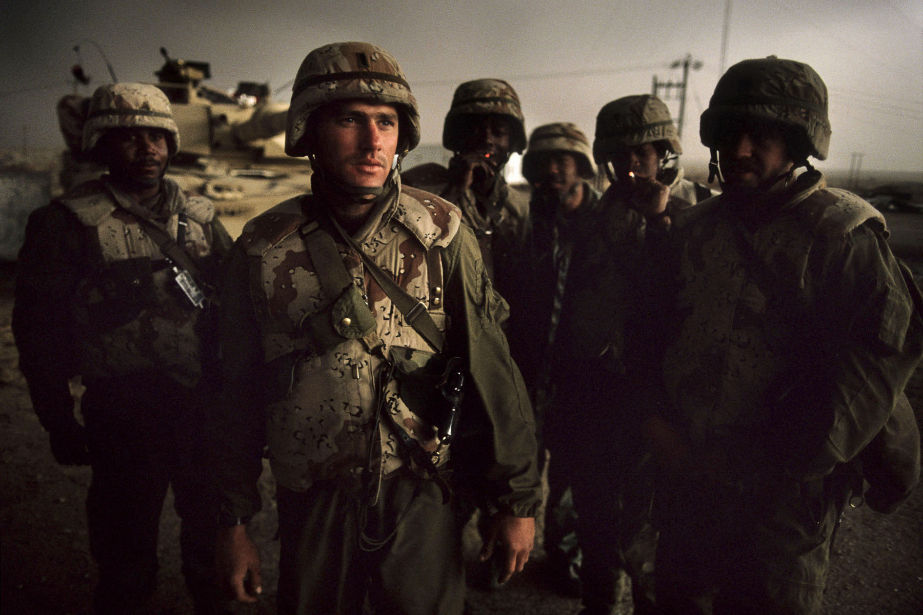 U.S. soldiers pose by their Abrams M1 tank on the road to Basra in February 1991