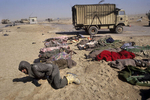 An Iraqi prisoner cries by his friends' corpses on the road to Basra in February 1991