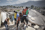 In the Nazon area young men searching for their parents' bodies in the ruins of their house on January 23, 2010