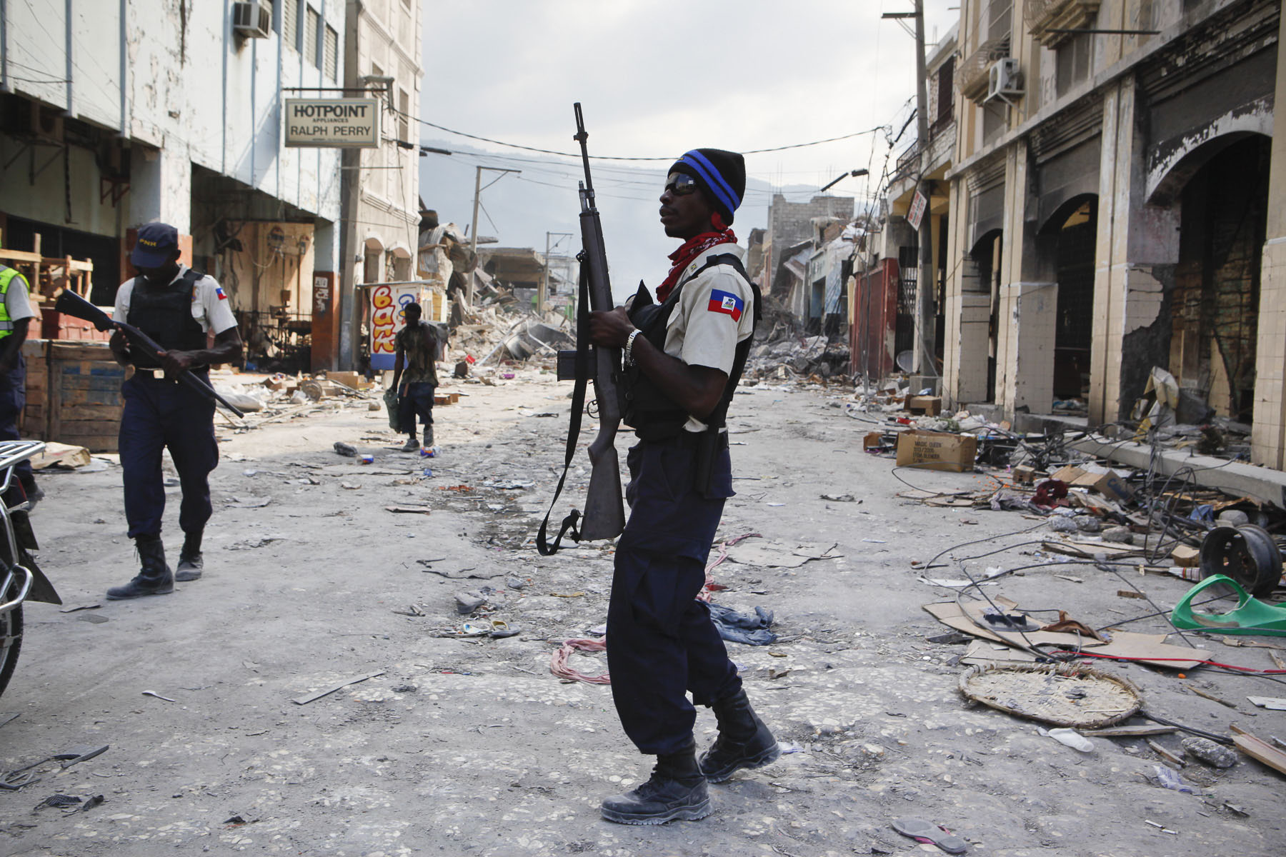 Haitian police stops looting downtown on January 24, 2010