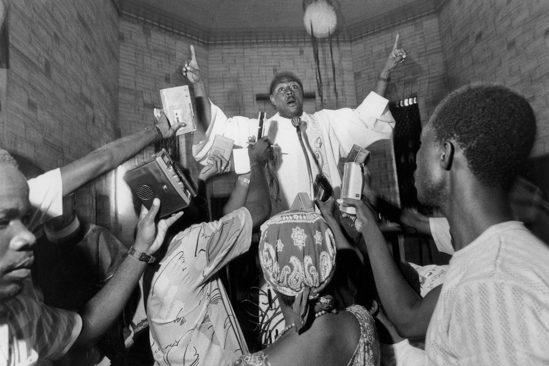 Father Devalcin preaching during a mass in the Saint-Marc church in August 1986