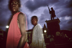 Two children on Cathedral Place beneath the statue of Jean-Jacques Dessalines, the 1st emperor of Haiti in October 2003