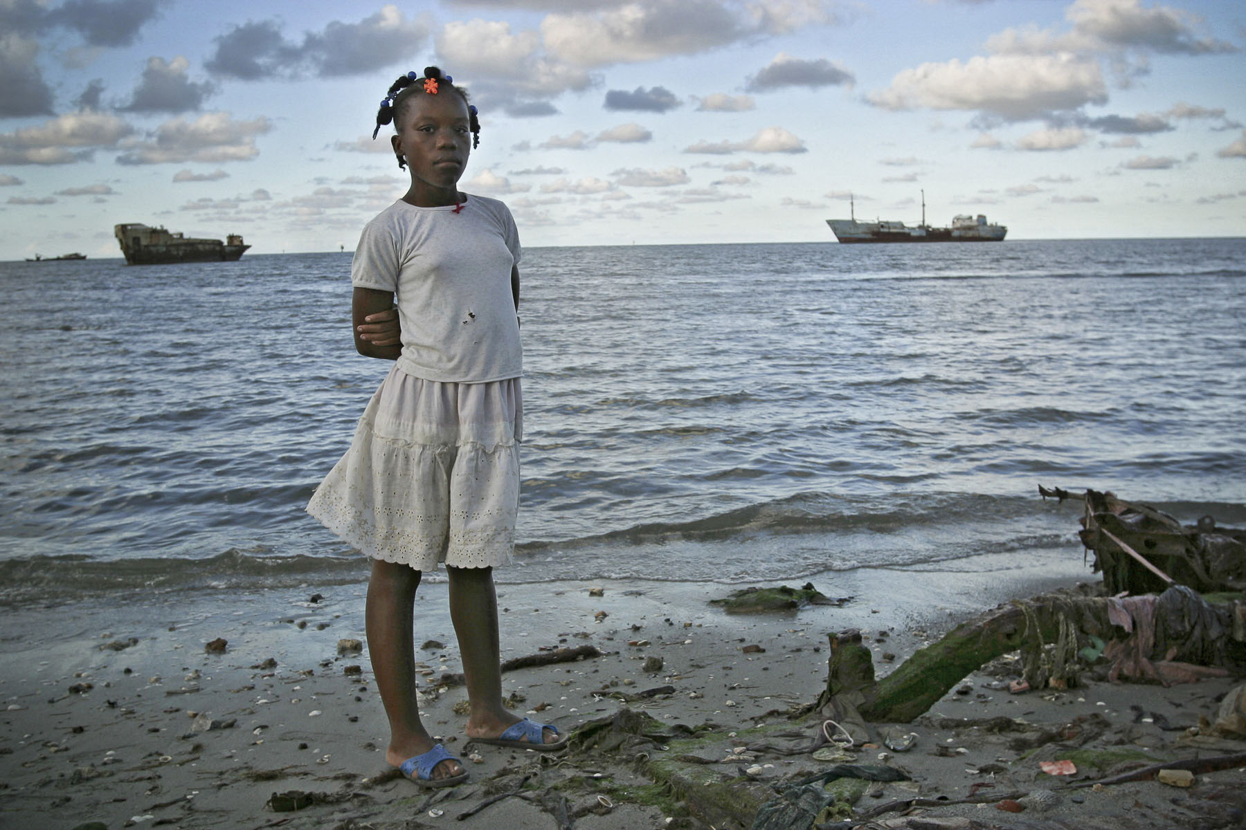 A girl in Bas-Aviation slums located at the end of the airport runways. in October 2003