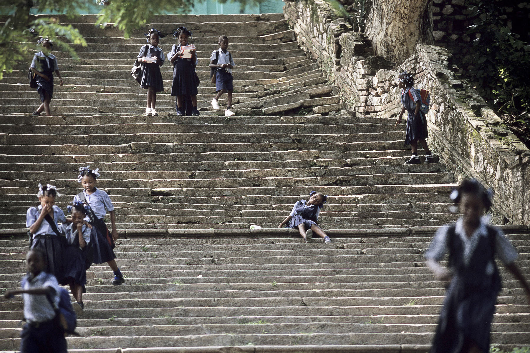 Pupils climbing down the stairs of the Sans-Souci palace built in 1806 by King Christophe and destroyed by the 1842 earthquake in October 2003
