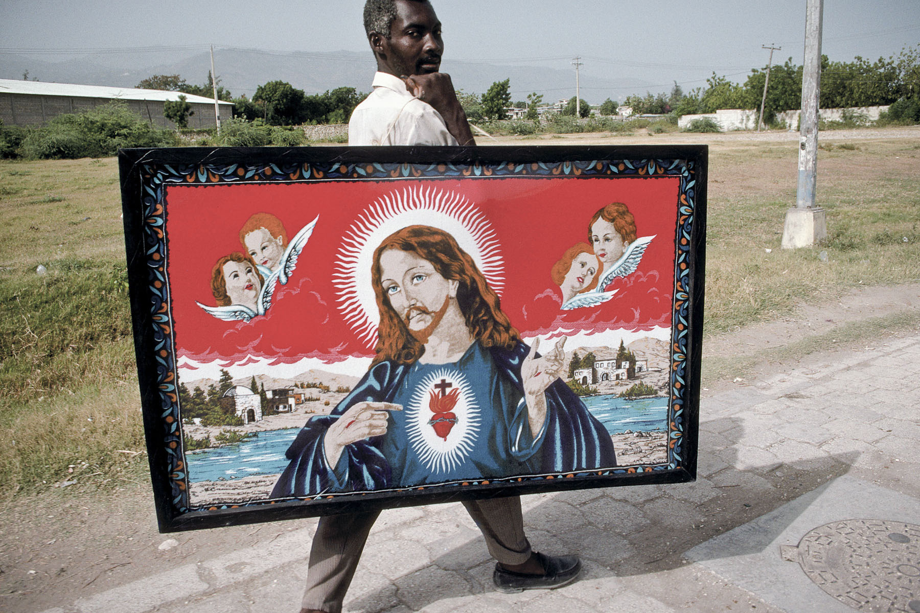 Man carrying a religious painting in October 2003