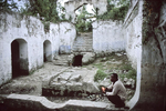 In the ruins of the Duplaa estate, a former plantation, a voodoo adept prays to  Lovana, a voodoo spirit and the new mistress of the house in October 2003
