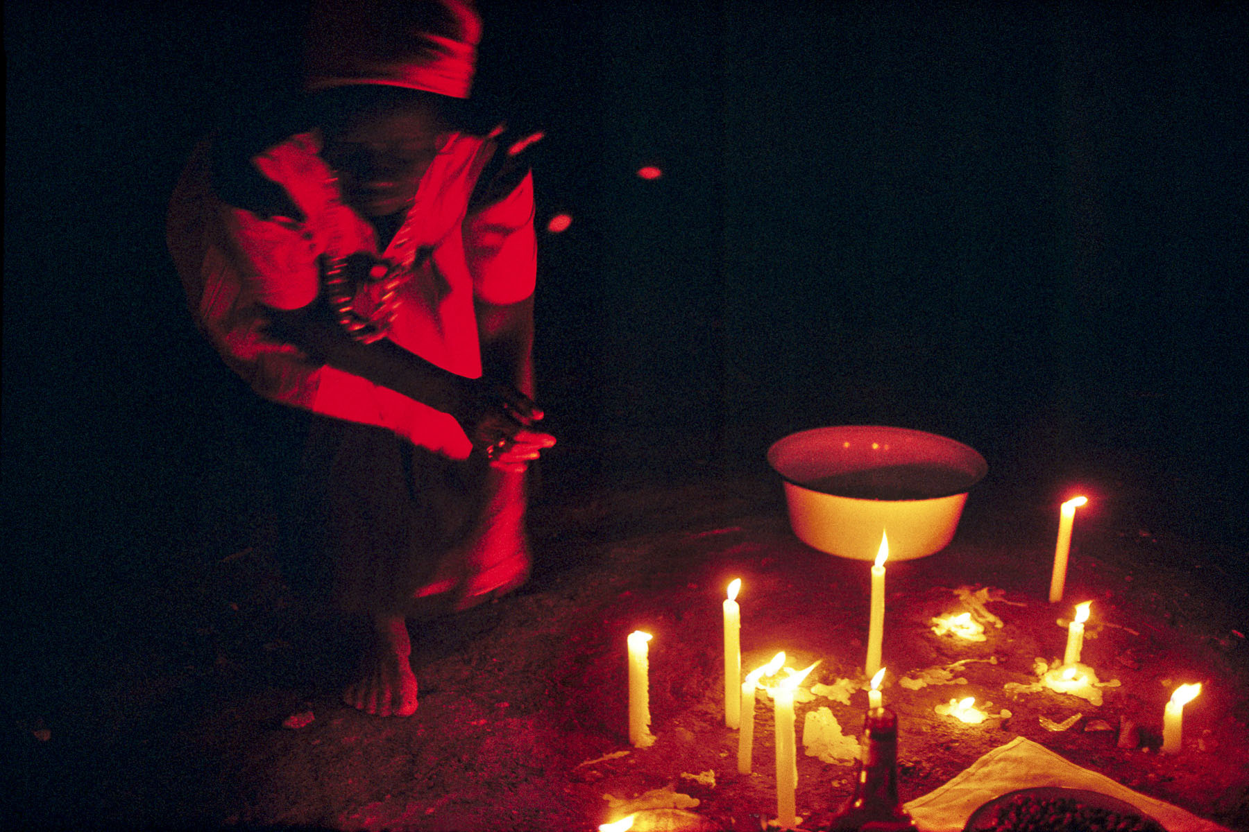 On Twelfth Night a mambo (voodoo priestess) dancing in front of the altar dedicated to the loas (spirits) protectors of the community in January 1997