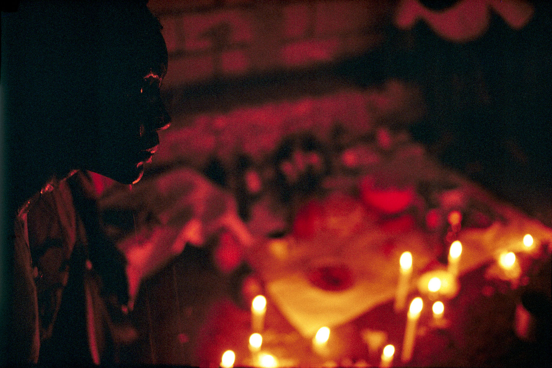 On Twelfth Night a believer is being looked after in front of the altar consecrated to the loas (spirits) protectors of the community in January 1997