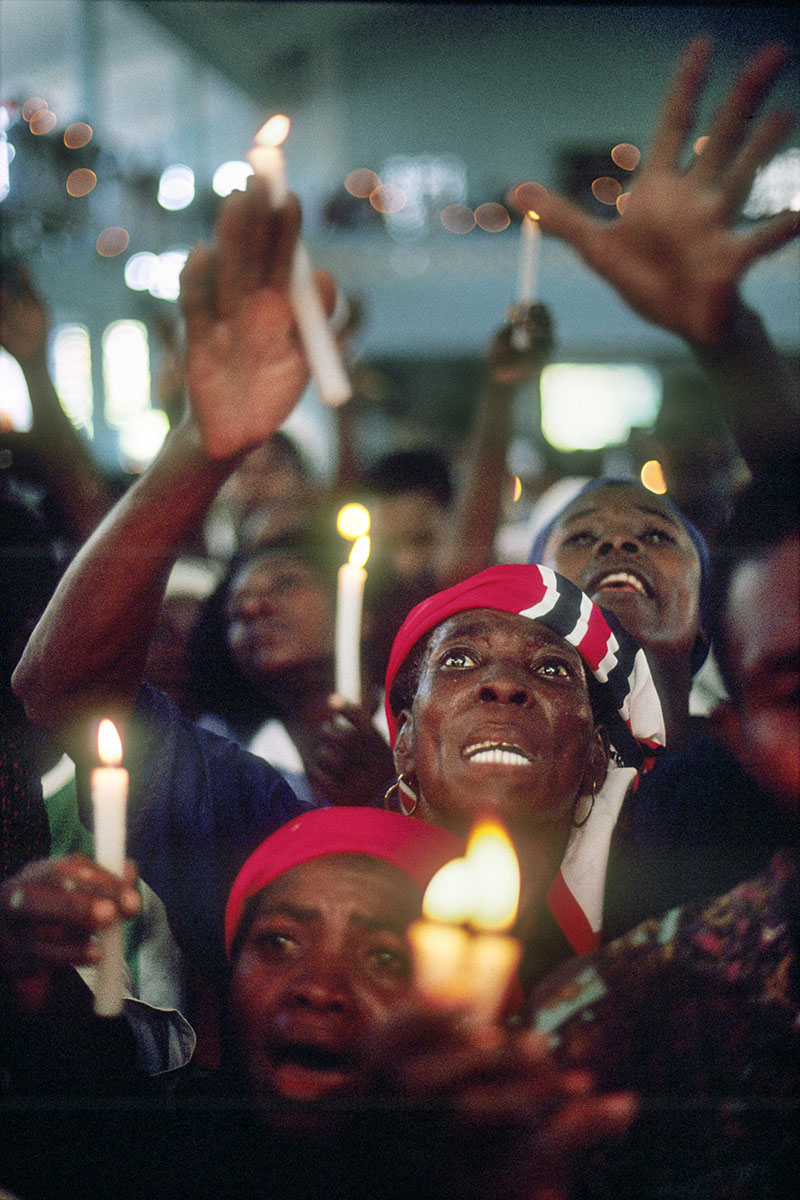 On the day of Our Lady of Mount Carmel believers praying in the church in July 1995