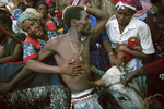 A community of farmers from the Artibonite preparing to sacrifice a bull to the loa (spirit) Ogou Feray during the annual pilgrimage in July 1995