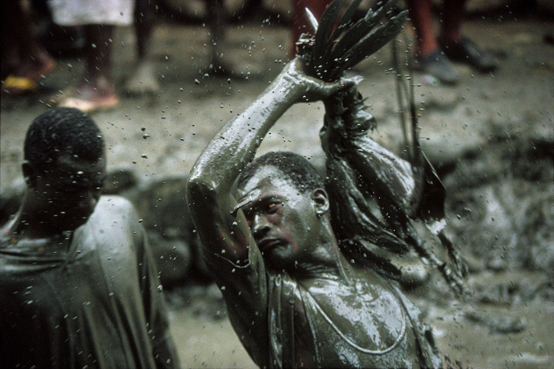A believer sacrifices a rooster during the annual pilgrimage dedicated to the loa (spirit) Ogou Feray in July 1994