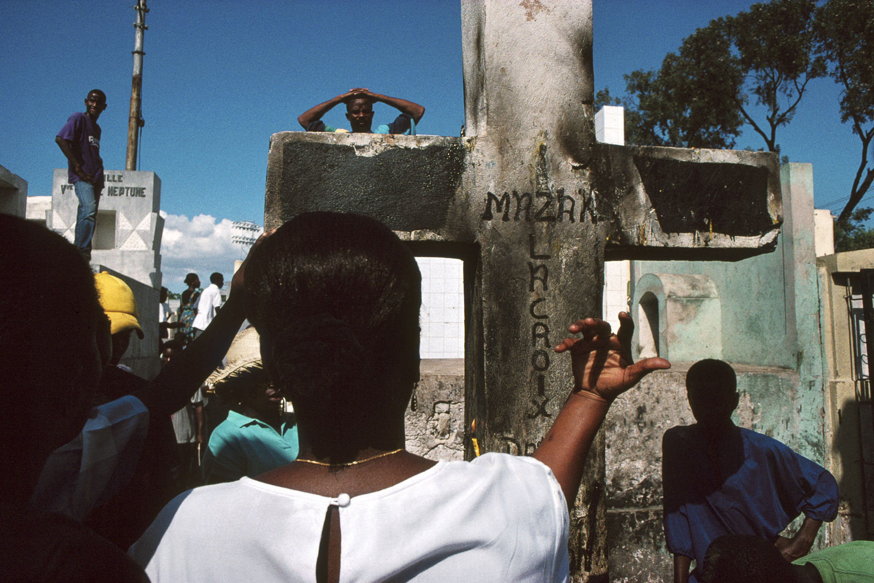 On All Saints' Day, the Guédés celebration. The voodoo followers gather in the cemeteries around the Cross of Baron Samedi, loa (spirit) of the dead in November 1995
