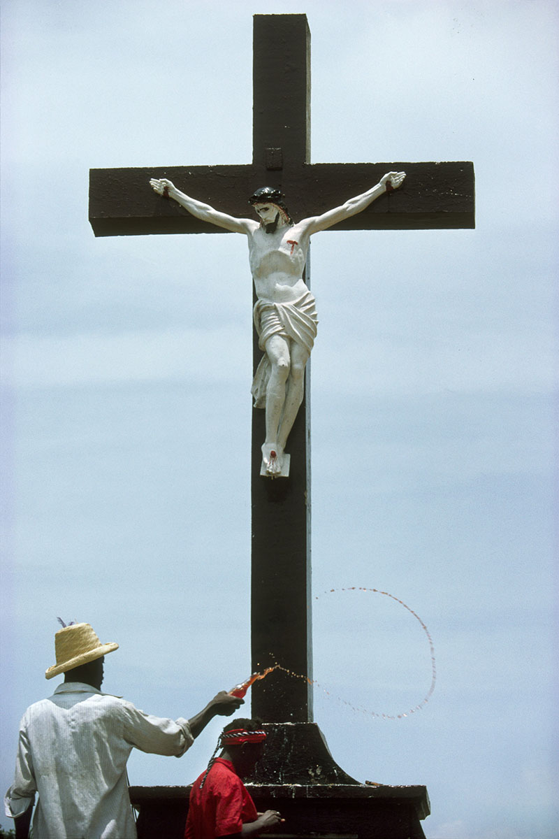 Healing seance under the village crucifix in July 1995