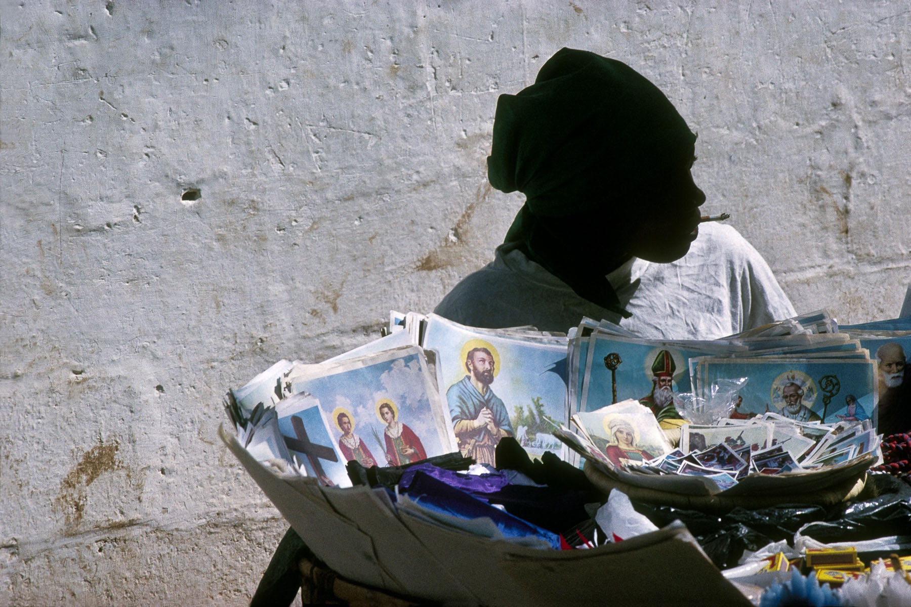 A seller of holy pictures in front of the Dezermit church next to Pétion-Ville. The loas (voodoo spirit) and the catholic saints in November 1996